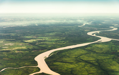 Landscape aerial view of colorful Amazon rivers, forest with trees, jungle, and fields - fototapety na wymiar