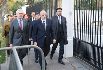 Chilean national prosecutor Jorge Abbott (C) arrive at a apostolic nunciature for a meeting with Special Vatican envoys archbishop Charles Scicluna and father Jordi Bertomeu in Santiago