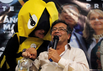 Colombian presidential candidate Gustavo Petro greets a supporter at a meeting, ahead of Sunday's presidential race, in Medellin