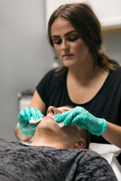 Spa: Male Customer Receives Relaxing Facial During Treatment