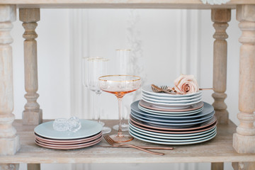 Stack of plates and wineglasses