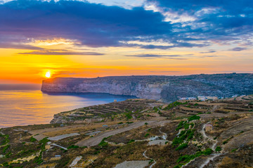 Wall Mural - Sunset view over Sanap cliffs on Gozo, Malta