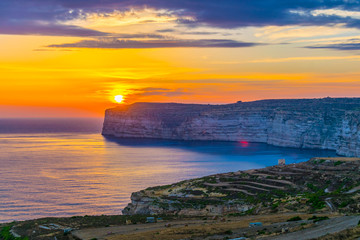 Fototapete - Sunset view over Sanap cliffs on Gozo, Malta