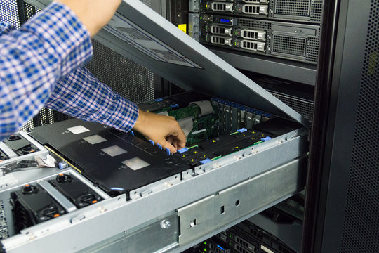 Technician working inside a server in a server room