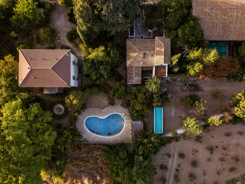 Aerial view of typical country houses with pools in Andalusia, Spain