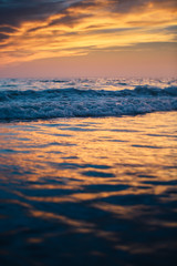 Beautiful sunset reflected on the sea waves