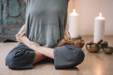 Woman in lotus asana
