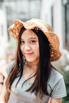 Asian young woman portrait with straw hat