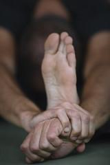 Man stretching arm and meditating