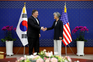 U.S. Secretary of State Mike Pompeo is greeted by South Korean Foreign Minister Kang Kyung-wha during a bilateral meeting at the Foreign Ministry in Seoul