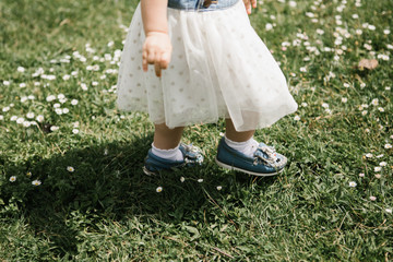 Toddlers feet walking in field of flowers