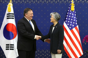 U.S. Secretary of State Mike Pompeo shakes hands with South Korean Foreign Minister Kang Kyung-wha  during their meeting at the Foreign Ministry in Seoul