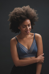 Studio Portrait Of Beautiful Mixed Race Woman With Afro Hairstyle