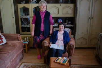 Mother and daughter with down's syndrome at home