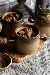 Winter warmer meat stew served in individual pots.