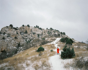 Woman standing on hill path
