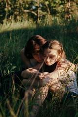 Mother hugging her upset daughter outdoors