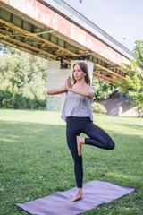 Beautiful Girl Doing her Yoga Session in the Park.