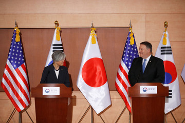 U.S. Secretary of State Mike Pompeo and South Korean Foreign Minister Kang Kyung-wha look on during a joint news conference with Japan's Foreign Minister Taro Kono at the Foreign Ministry in Seoul