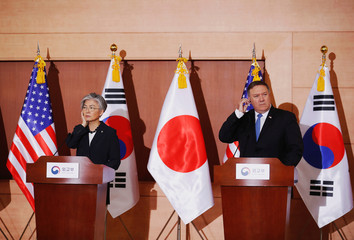U.S. Secretary of State Mike Pompeo, South Korean Foreign Minister Kang Kyung-wha and Japan's Foreign Minister Taro Kono attend a joint news conference at the Foreign Ministry in Seoul