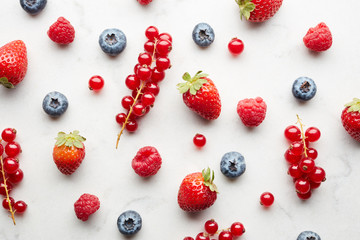 Bright berries on white background.