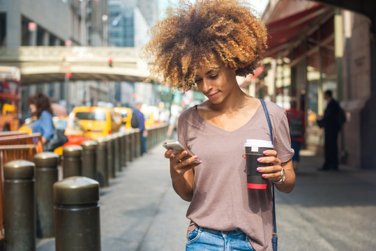 Young woman using phone outside Grand Central