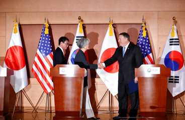 U.S. Secretary of State Mike Pompeo shakes hands with South Korean Foreign Minister Kang Kyung-wha next to Japan's Foreign Minister Taro Kono after a joint news conference at the Foreign Ministry in Seoul,