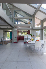 Interior of a contemporary house kitchen and dining area.