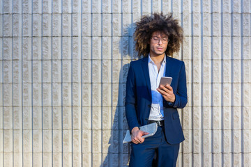 Young Businessman with Afro Hair Looking at Mobile Phone
