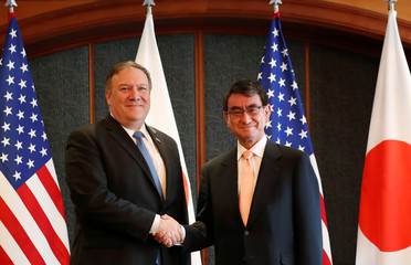 U.S. Secretary of State Mike Pompeo shakes hands with Japan's Foreign Minister Taro Kono during a bilateral meeting at a hotel in Seoul