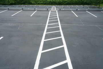 new paved empty parking lot with new painted strip lines