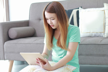 Young woman using tablet at home.