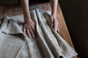 Baker kneading dough for artisan bread