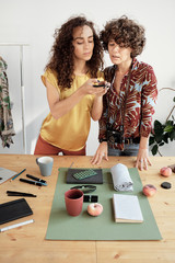 Women shooting flat lay composition
