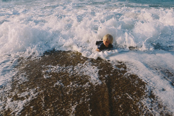 Baby girl fallen into the wave