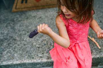 popsicle dripping down child's arm