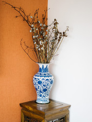 Painted decorative vase on table