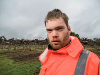 Man with High Visibility Jacket on Farm