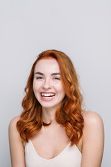 Studio Portrait Of Smiling Redhead Girl