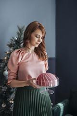 Woman Holding Christmas Cake