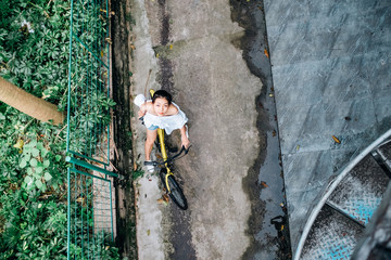 Asian young teenager on a bike