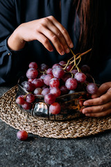Woman holding fresh juicy grape