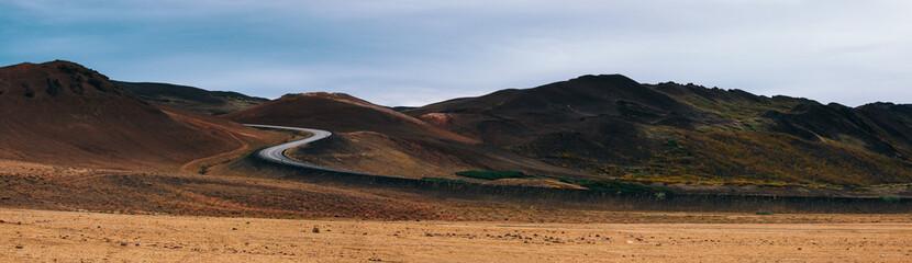 S Curve Through Colorful Volcanic Landscape