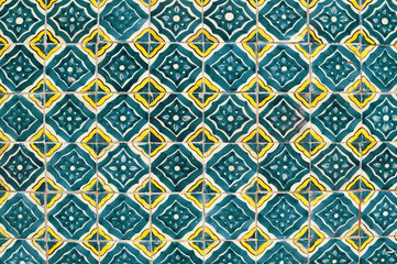Mexican ceramic mosaic wall, green tile background texture.