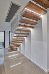Floating staircase design in modern home