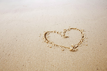 hearts drawn in beach.honeymoon or valentine's day concept