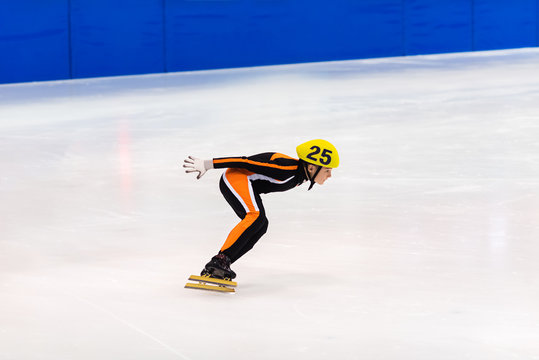 Speed skater racing  in an ice rink