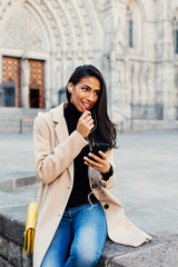 Portrait of a smiling stylish woman talking on mobile phone.