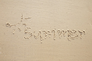 Word summer written by in the sand