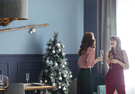 Women Chatting at Christmas Celebration